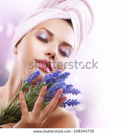 Spa Girl with Lavender Flowers.Organic Cosmetics. Beautiful Young Woman After Bath. Perfect Skin. Skincare. Young Skin - stock photo