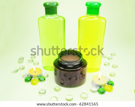 spa hair herbal shampoo candles oil essen?es among decorative pebble - stock photo