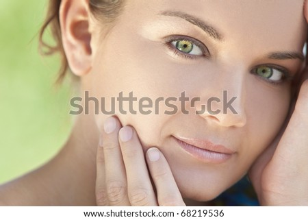 Spa Health and beauty portrait of a beautiful brunette young woman with stunning green eyes, shot outside in natural light - stock photo