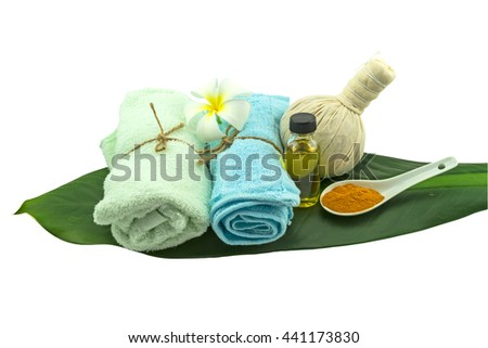 Spa herbal compressing ball , white frangipani flower , turmeric powder in white spoon massage oil and blue fabric in green leaf isolate on white background.Saved with clipping path