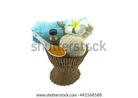 Spa herbal compressing ball , white frangipani flower  turmeric powder in white spoon massage oil and blue fabric  on bamboo basket isolate on white background.Saved with clipping path - stock photo