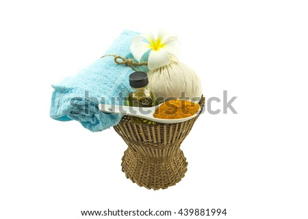 Spa herbal compressing ball , white frangipani flowers , turmeric powder in white spoon massage oil and blue fabric  on bamboo basket isolate on white background.Saved with clipping path. - stock photo