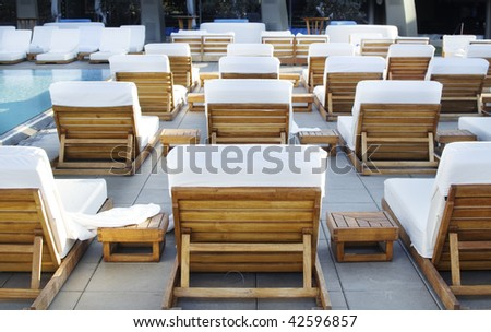 Spa holiday resort lounge deck area with swimming pool - stock photo