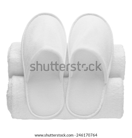Spa, hotel, wellness - home slippers with rolled towels isolated - stock photo