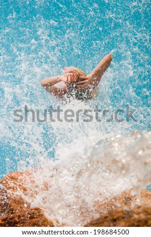 spa hydrotherapy woman waterfall jet turquoise swimming pool water - stock photo