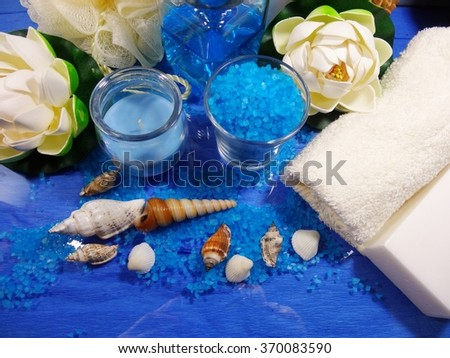 Spa in the colors blue - Aromatic soap, scented bath salt, and oil, and accessories for massage and bath - stock photo