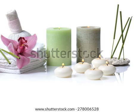 spa items with lilac orchid on white background