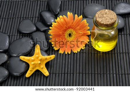 Spa life setting(gerbera and stones, Massage oil ,starfish,) - stock photo