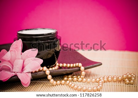 spa lotion cream with fashion accessories - stock photo