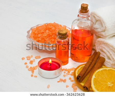 Spa. Marine bath salt and aromatic oil orange with cinnamon, burning candle. - stock photo