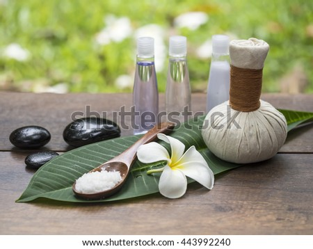 Spa massage compress balls, herbal ball on the leaves with rock spa, Thailand, select focus   - stock photo