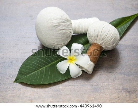 Spa massage compress balls, herbal ball on the leaves with spa flower, Thailand, select focus  - stock photo