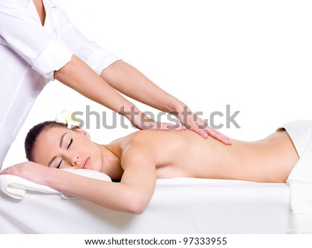 Spa massage for beautiful pretty woman - isolated on white background - Beauty treatment therapy - stock photo