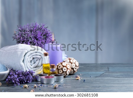 spa massage setting, lavender product, oil on wooden background - stock photo