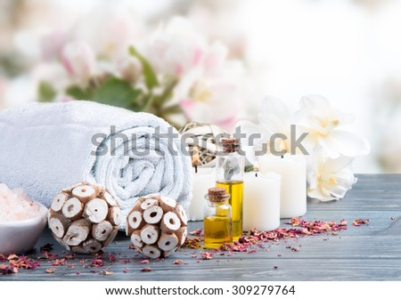 spa massage setting, product, oil on wooden background - stock photo