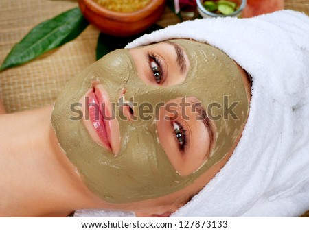 Spa Mud Mask. Woman in Spa Salon. Face Mask. Facial Clay Mask. Treatment