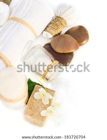 Spa objects: soap, salt, daisy, candle, towel - stock photo