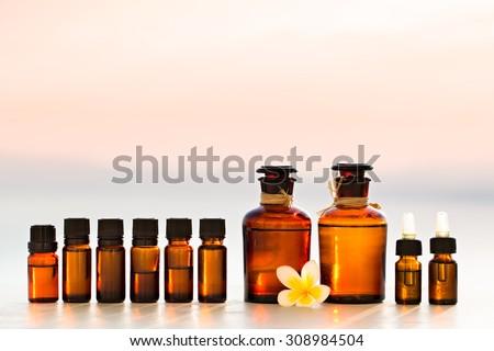 Spa oils in bottles on sunset - stock photo
