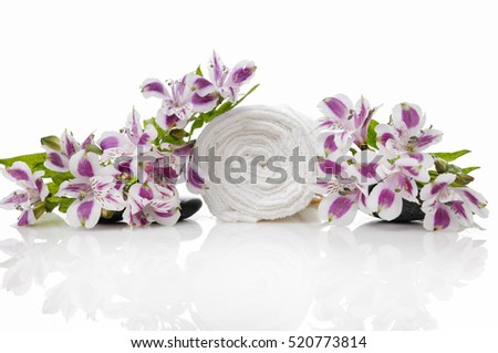 Spa orchid flower with white cotton towels setting