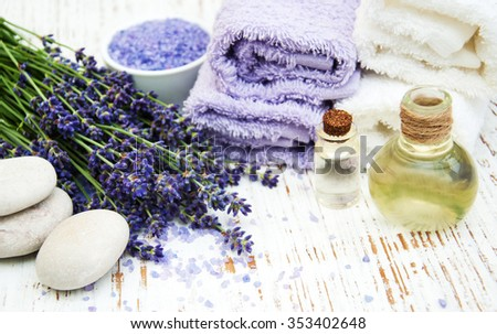 Spa products and lavender flowers on a old wooden background - stock photo