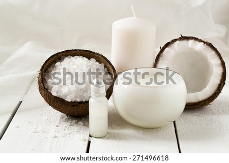 Spa products with coconut: sea salt, coconut oil, foam, coconut, scented candle - stock photo