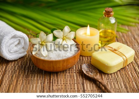 spa relax set on mat with palm, salt in bowl