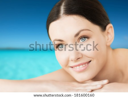 spa, resort and vacation concept - smiling woman lying on the beach