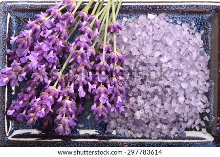 Spa resort and wellness composition - lavender flowers, coloured bathing salt - stock photo