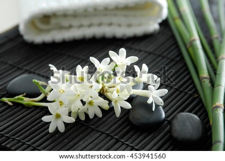 Spa resort â?? bamboo grove, flower, stones, towel on mat - stock photo
