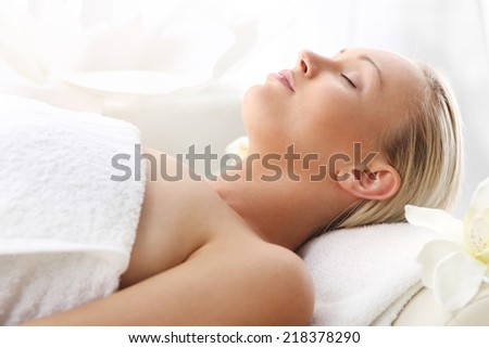 Spa - rest, relaxation, health . Attractive blonde woman in the office spa, relaxes August waiting for a cosmetic procedure.  - stock photo