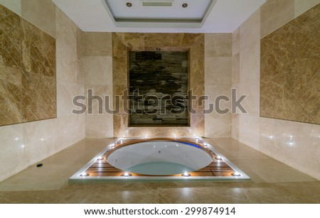 Spa room with burning candles - stock photo