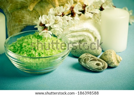 Spa salon design with sea salt and apricot flowers. For this photo applied toning in retro style. - stock photo