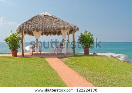 Spa salon on beach of tropical island - healthcare background - stock photo