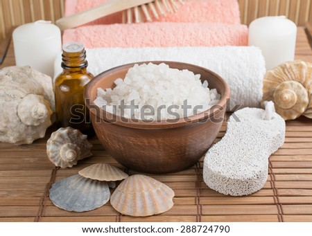 Spa salon with sea salt  on the bamboo board