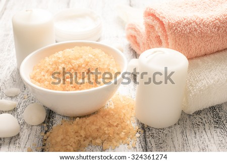 Spa salon with sea salt, towels, candle.  For this photo applied color toning effect. - stock photo