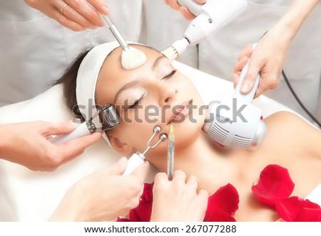 Spa Salon: Young Beautiful Woman Having Various Facial Treatment - stock photo