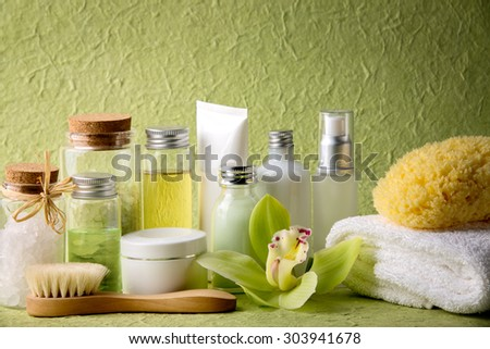 Spa salt,essential oil,towel,brush and blooming orchid. - stock photo