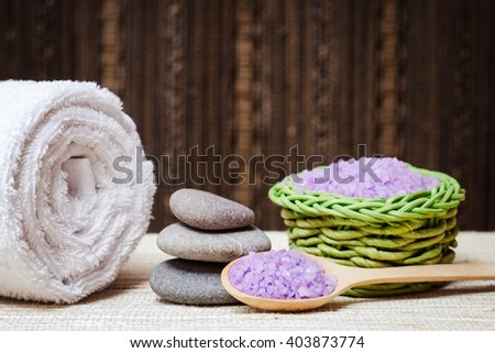 Spa salt, stones, towel  for beauty and health. Healthy relaxation, therapy and treatment. Aromatherapy, body care, aroma massage. Alternative lifestyle. Relax in bath. - stock photo