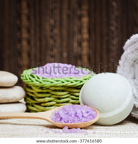 Spa salt, stones, towelm candle and bath bomb for beauty and health. Healthy relaxation, therapy and treatment. Aromatherapy, body care, aroma massage. Alternative lifestyle. Relax in bath. - stock photo