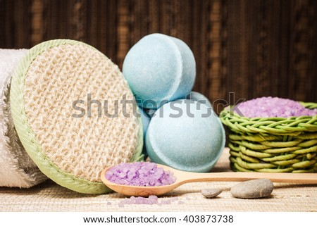 Spa salt, wisp, towel, stones and bath bomb for beauty and health. Healthy relaxation, therapy and treatment. Aromatherapy, body care, aroma massage. Alternative lifestyle. Relax in bath. - stock photo