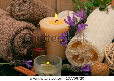 Spa scene with aromatic lavender, loofah and towels - stock photo