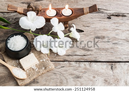 spa sea salt and orchid on wood background , relaxation - stock photo