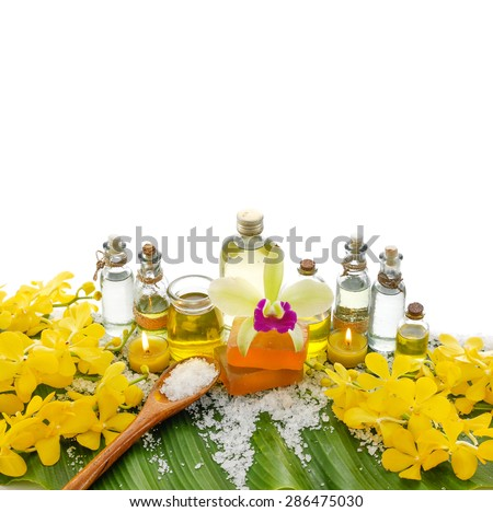Spa set on banana leaf ,yellow orchid - stock photo