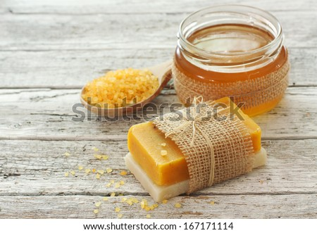 Spa set with honey ,soap and sea salt over natural background - stock photo