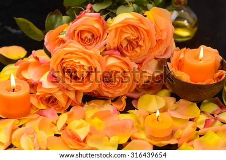 Spa Set with many rose petals with candle, oil  - stock photo