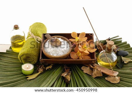spa set with oil ,candle ,towel,stones , on leaf - stock photo