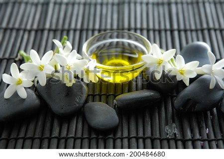 SPA set with pile stones ,white tuberose,oil,on mat