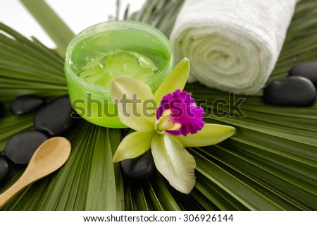 Spa set with towel,orchid on palm texture - stock photo