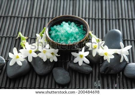SPA set with tuberose flower ,salt in bowl, stone mat - stock photo