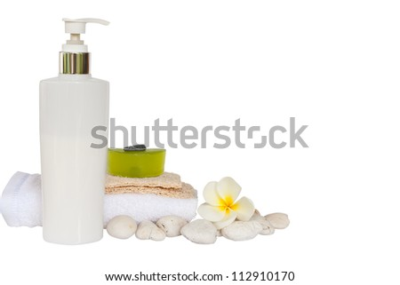 Spa set with white flower,towels and green herb soap isolated with clipping path
